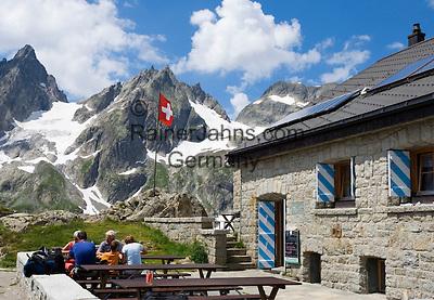 Switzerland, Canton Uri, at Sustenpass Road - border between cantone Bern + Uri: Sustli mountain hut, Fuenffingerstock mountains with peaks Wendenhorn und Wasenhorn (f.l.t.r.)
