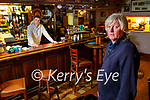 Michael Leen in his pub in Ballyheigue with his son Michael behind the bar.