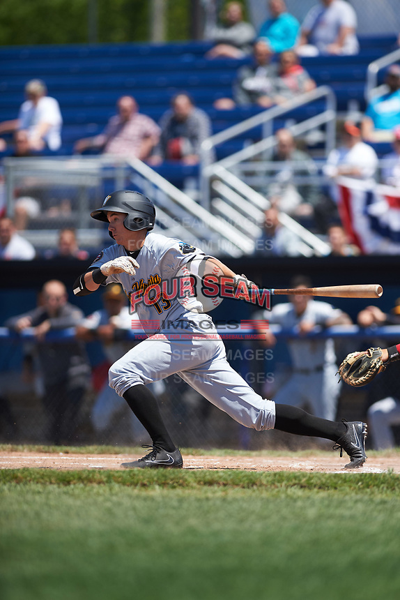 West Virginia Black Bears shortstop Andrew Walker (13) hits a single during a game against the Batavia Muckdogs on June 25, 2017 at Dwyer Stadium in Batavia, New York.  West Virginia defeated Batavia 6-4 in the completion of the game started on June 24th.  (Mike Janes/Four Seam Images)