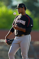 Kannapolis Intimidators starting pitcher Jefferson Olacio (40) flips the ball as he waits for the inning to start during the South Atlantic League game against the Hickory Crawdads at L.P. Frans Stadium on May 25, 2013 in Hickory, North Carolina.  The Crawdads defeated the Intimidators 14-3.  (Brian Westerholt/Four Seam Images)