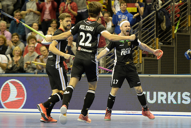 Berlin, Germany, February 10: During the FIH Indoor Hockey World Cup semi-final match between Germany (black) and Iran (white) on February 10, 2018 at Max-Schmeling-Halle in Berlin, Germany. Final score 6-2. (Photo by Dirk Markgraf / www.265-images.com) *** Local caption *** Martin HAENER #6 of Germany, Christopher RUEHR #17 of Germany, Marco MILTKAU #22 of Germany