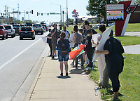 Students from Farmington High School and Junior High School listen to organizers Friday, April 30, 2021, as they protest along main street near the junior high school after a student was allegedly attacked Tuesday at the school by at least one fellow student. Visit nwaonline.com/210501Daily/ for today's photo gallery. <br /> (NWA Democrat-Gazette/Andy Shupe)