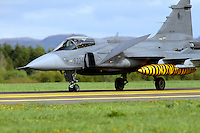 Check JAS Gripen with tiger painted fuel tank. Nato Tiger Meet is an annual gathering of squadrons using the tiger as their mascot. While originally mostly a social event it is now a full military exercise. Tiger Meet 2012 was held at the Norwegian air base Ørlandet.