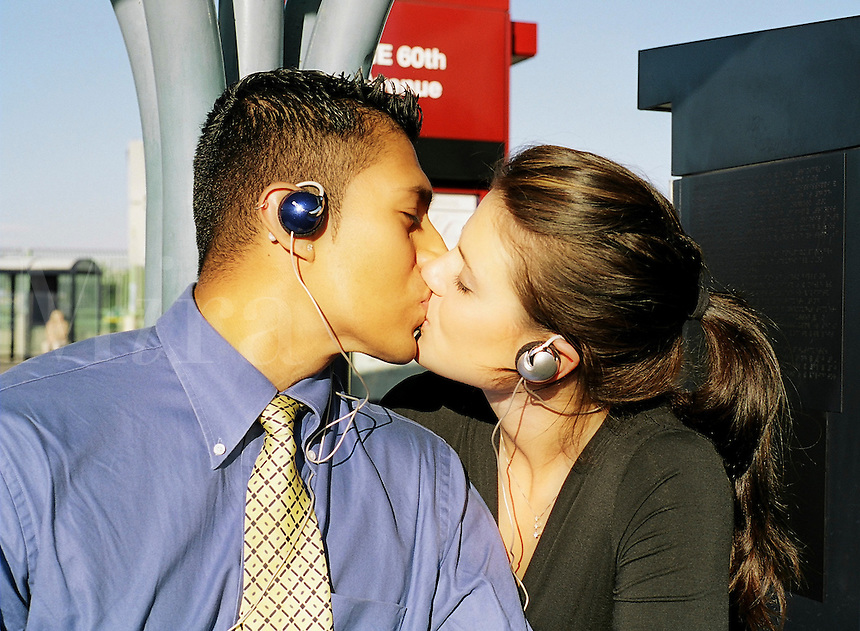 Young professional couple kiss and listen to music..MR