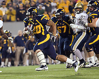 WVU running back Shawne Alston. The WVU Mountaineers beat the Pitt Panthers 21-20 at Mountaineer Field in Morgantown, West Virginia on November 25, 2011.
