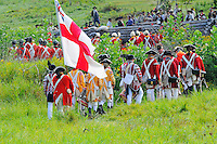 British redcoats with musicians, leave the battlefield after a Revolutionary War re-enactment at Fort Ticonderoga, New York, USA.