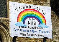 St Marys Church in Goldington, Bedford, UK has a new Clap for our carers rainbow sign outside 'Thank God for the NHS and all front line staff' encouraging people to Give them a clap on Thursday. The Coronavirus (Covid 19) pandemic has now claimed over 20,000 lives in the UK. Tuesday April 28th 2020<br /> <br /> Photo by Keith Mayhew