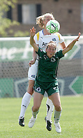 Kerri Hanks (green) gets beate to the ball by Allison Faulk...Saint Louis Athletica and LA Sol played to a 0-0 tie at Robert Herman Stadium, St Louis, MO.