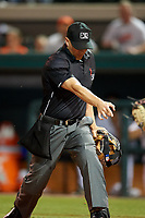 Home plate umpire Sam Burch calls Tampa Tarpons base runner Francisco Diaz (not shown) safe after a play at the plate during a game on April 5, 2018 at Publix Field at Joker Marchant Stadium in Lakeland, Florida.  Tampa defeated Lakeland 4-2.  (Mike Janes/Four Seam Images)