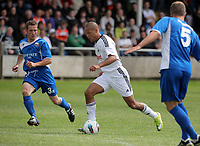 Pictured: Casey Thomas of Swansea (C) against Kye Edwards (R) and Paul Keddle (L) of Port Talbot. Saturday 17 July 2011<br />