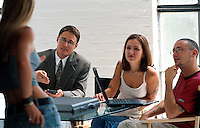 Young adults in a business setting as they meet with an investor.