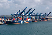 Colon, Panama.  Container Ship and Container Cranes in the Port.