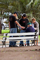 South America, Argentina, Almirante Brown, Adrogue, Evangelism - International missionaries along with locals evangelize on the streets of Adrogue, July 2006, ©Stephen Blake Farrington<br />