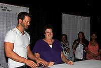 "Days of Our Lives Eric Martsolf ""Brady Black"" with fans as he appears at the 12th Annual Comcast Women's Expo on September 7 (also 6th), 2014 at the Connecticut Convention Center, Hartford, CT. He signed photos, posed with fans, walked the runway with models from Kathy Faber Designs Fashion Show, and broke some boards at Villari's Martial Arts Centers booth with Maggie and Ryan Farley.  (Photo by Sue Coflin/Max Photos)"