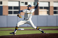 Michigan Wolverines pitcher Ben Dragani (21) delivers a pitch to the plate during the NCAA baseball game against the Illinois Fighting Illini at Fisher Stadium on March 19, 2021 in Ann Arbor, Michigan. Illinois won the game 7-4. (Andrew Woolley/Four Seam Images)