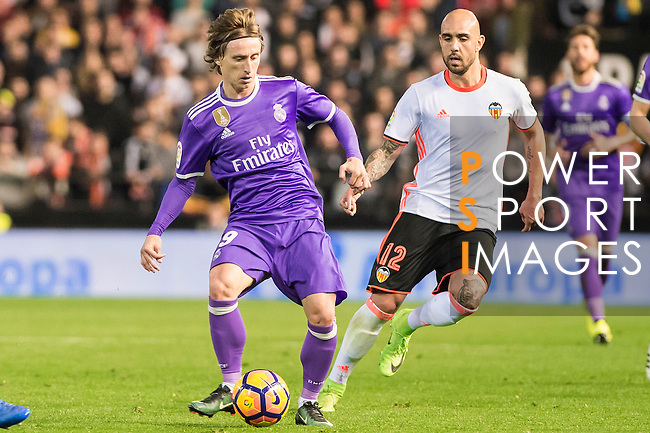 Luka Modric (l) of Real Madrid battles for the ball with Simone Zaza of Valencia CF during their La Liga match between Valencia CF and Real Madrid at the Estadio de Mestalla on 22 February 2017 in Valencia, Spain. Photo by Maria Jose Segovia Carmona / Power Sport Images