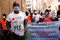 The Ivorian trade unionist Aboubakar Soumahoro with the agricultural laborers during a demonstration ' The invisibles' to ask for more rights at work. <br /> Rome (Italy), May 18th 2021<br /> Photo Samantha Zucchi Insidefoto