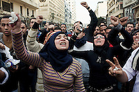 Protesters march through the streets of central Cairo. Continued anti-government protests take place in Cairo calling for President Mubarak to stand down. After dissolving the government, Mubarak still refuses to step down from power.