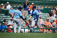 Tampa Bay Rays designated hitter Austin Meadows (17) is congratulated by third base coach Rodney Linares (27) as he rounds third base after hitting a home run in the top of the fourth inning during a Grapefruit League Spring Training game against the Baltimore Orioles on March 1, 2019 at Ed Smith Stadium in Sarasota, Florida.  Rays defeated the Orioles 10-5.  (Mike Janes/Four Seam Images)