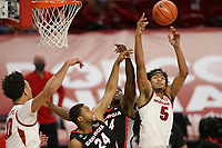 Arkansas guard Moses Moody (5) rebounds, Saturday, January 9, 2021 during the second half of a basketball game at Bud Walton Arena in Fayetteville. Check out nwaonline.com/210110Daily/ for today's photo gallery. <br /> (NWA Democrat-Gazette/Charlie Kaijo)