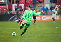 Toronto, Ontario - May 3, 2014: Toronto FC goalkeeper Julio Cesar #30 in action during a game between the New England Revolution and Toronto FC at BMO Field.<br /> The New England Revolution won 2-1.