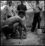 Customers wait while the turtle is tied up for transport. .