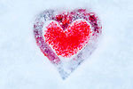 Christmas season with heart drawn in snow with sprinkles.
