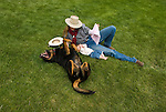 Crystalin Chrisensen with her daughter, Caden, and dog, Gus lay in the grass at the Jordan Valley Big Loop Rodeo..