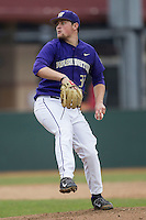 Washington Huskies pitcher Henry Baker (32) delivers a pitch to the plate during the NCAA baseball game against the Michigan Wolverines on February 16, 2014 at Bobcat Ballpark in San Marcos, Texas. The game went eight innings, before travel curfew ended the contest in a 7-7 tie. (Andrew Woolley/Four Seam Images)