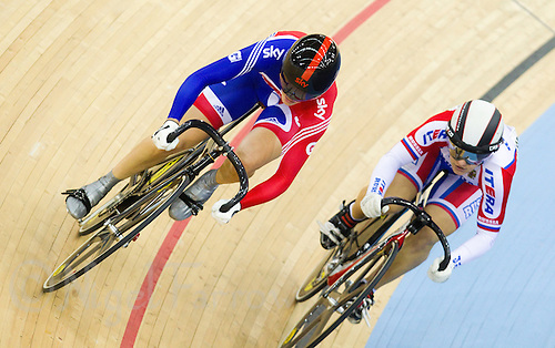 18 FEB 2012 - LONDON, GBR - Great Britain's Victoria Pendleton (left, in blue and red) passes Russia's Viktoria Baranova (RUS) during their Women's Sprint 1/8 round heat at the UCI Track Cycling World Cup, and London Prepares test event for the 2012 Olympic Games, in the Olympic Park Velodrome in Stratford, London, Great Britain .(PHOTO (C) 2012 NIGEL FARROW)