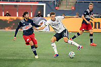 FOXBOROUGH, MA - OCTOBER 19: Jack Elliott #3 of Philadelphia Union pivots under pressure from Lee Nguyen #42 of New England Revolution during a game between Philadelphia Union and New England Revolution at Gillette on October 19, 2020 in Foxborough, Massachusetts.