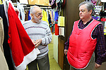 WATERBURY CT. 22 December 2017-122217SV06-Mike Patrick, Republican American, sees what it feels like to transform into Santa at Arabesque on Bank Street in Waterbury Friday. Michael Rinaldi, owner, left, dressed Mike.<br /> Steven Valenti Republican-American
