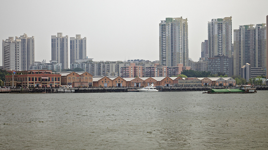 China Navigation Company godowns in Haizhu (Honam Island), Guangzhou (Canton).  The photograph was from the opposite riverbank on what was known as Gough Island.  And this tributary of the Pearl River was once referred to as Canton's back reach to Macau.  The godowns have been restored and as of October 2017, were slowly filling with bars, restaurants and the commercial interests.