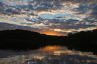 Sunsets and reflects over the Rivanna River in Albemarle County, VA. Photo/ AndrewShurtleff