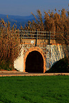 Walking way next to an aqueduct in the area of Pla del Bages with end in the Parc de la Sequia