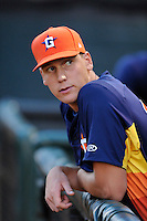 Pitcher Brock Dykxhoorn (62) of the Greeneville Astros leans on the dugout rail and watches the start of a game against the Bristol Pirates on Saturday, July 26, 2014, at DeVault Memorial Stadium in Bristol, Virginia. Greeneville won, 4-0 in Game 2 of a doubleheader. (Tom Priddy/Four Seam Images)