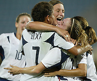 23 August 2004:  Shannon Boxx and Abby Wambach celebrate with Heather O'Reilly after O'Reilly scored a goal in overtime against Germany during the semifinal game at Pankritio Stadium in Heraklio, Greece.     USA defeated Germany, 2-1 in overtime,  .   Credit: Michael Pimentel / ISI
