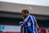 20th March 2021, Oakwell Stadium, Barnsley, Yorkshire, England; English Football League Championship Football, Barnsley FC versus Sheffield Wednesday; Captains hug from Barry Bannan of Sheffield Wednesday as Jordan Rhodes of Sheffield Wednesday makes it 1-0 after 38 minutes