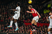 Saturday 11 January 2014 Pictured: Wilfried Bony and Luis Antonio Valencia jump for the ball <br /> Re: Barclays Premier League Manchester Utd v Swansea City FC  at Old Trafford, Manchester