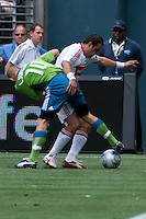 Freddie Ljungberg (10) of the Seattle Sounders fights with Cuauhtemoc Blanco (R) of the Chicago Fire in the match at the XBox Pitch at Quest Field on July 25, 2009. The Sounders and Fire played to a 0-0 draw.