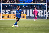 SAN JOSE, CA - MAY 01: Jackson Yueill #14 of the San Jose Earthquakes looks up to pass the ball during a game between San Jose Earthquakes and D.C. United at PayPal Park on May 01, 2021 in San Jose, California.
