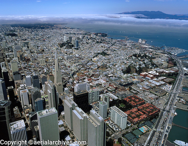 aerial photograph of the Embarcadero Center and Transamerica Pyramid with view to Golden Gate in fog, San Francisco, California