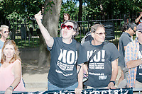 "Counterprotesters hold signs toward, flip-off, and angrily shout at those marching in the Straight Pride Parade in Boston, Massachusetts, on Sat., August 31, 2019. The parade was organized in reaction to LGBTQ Pride month activities by an organization called Super Happy Fun America. The people's shirts here read ""NO! In the name of humanity we refuse to accept a fascist America. Refusefascism.org"""