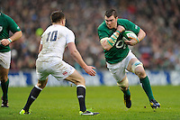 Peter O'Mahoney of Ireland in action against Owen Farrell of England during the RBS 6 Nations match between Ireland and England at the Aviva Stadium, Dublin on Sunday 10 February 2013 (Photo by Rob Munro)