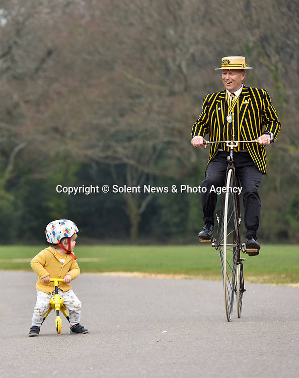 Pictured: Stuart Mason-Elliott, also known as Mr Samuel Pickwick as President of the oldest cycling club in the world The Pickwick Bicycle Club, rides his original 1872 Coventry Machinist Company penny farthing wearing the traditional club uniform alongside Arthur Naish (2) on his tricycle at Southampton Common in Southampton, Hants.<br /> <br /> Stuart rides a 22 kilogram, iron frame penny farthing which is believed to be one of the first bicycles ever made. The wheel diameter is 48 inches, with each bicycle being specially tailored to the leg length of the rider.<br /> <br /> Stuart was elected president of The Pickwick Bicycle Club, formed in 1870for the second consecutive year, due to Covid-19 restrictions on club activities. Members wear the traditional club uniform of a yellow and black striped blazer, waistcoat with a straw boater hat and are also assigned a sobriquet of a character from The Pickwick Papers, which they represent.<br /> <br /> © Jordan Pettitt/Solent News & Photo Agency<br /> UK +44 (0) 2380 458800