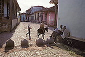 Man riding a donkey in the southern town of Trinidad, which was declared a World Heritage site by UNESCO in 1988 to preserve the architectural legacy of its Spanish colonial history.