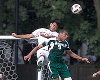 Boston College defender/forward Kevin Mejia (12) and George Mason University forward Taylor Morgan (9) battle for head ball. Boston College defeated George Mason University, 3-2, at Newton Soccer Field, August 26, 2011.