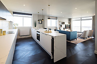 BNPS.co.uk (01202 558833)<br /> Picture: Savills/BNPS<br /> <br /> Pictured: The kitchen and lounge.<br /> <br /> HOWZAT for a view?<br /> <br /> A luxury flat that has grandstand views of Lords cricket ground has gone on the market for £2.72m.<br /> <br /> The two-bed apartment is on the 11th floor of a building next to the 'home of cricket'.<br /> <br /> From the balcony, there are uninterrupted views of the cricket pitch.