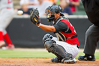 Catcher Miguel Gonzalez #32 of the Kannapolis Intimidators catches a pitch during the South Atlantic League game against the Lakewood BlueClaws at Fieldcrest Cannon Stadium on July 16, 2011 in Kannapolis, North Carolina.  The Intimidators defeated the BlueClaws 5-3.   (Brian Westerholt / Four Seam Images)
