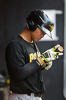Connor Joe (23) of the West Virginia Power checks his bat during the game against the Hickory Crawdads at L.P. Frans Stadium on August 15, 2015 in Hickory, North Carolina.  The Power defeated the Crawdads 9-0.  (Brian Westerholt/Four Seam Images)